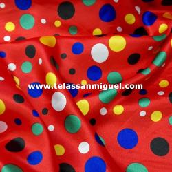 Raso carnaval estampado lunares multicolores fondo rojo