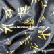 Raso carnaval estampado letras chinas fondo negro