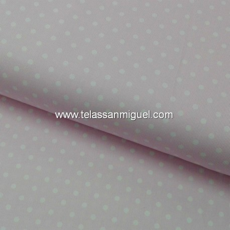 Piqué de canutillo fondo rosa y lunar blanco